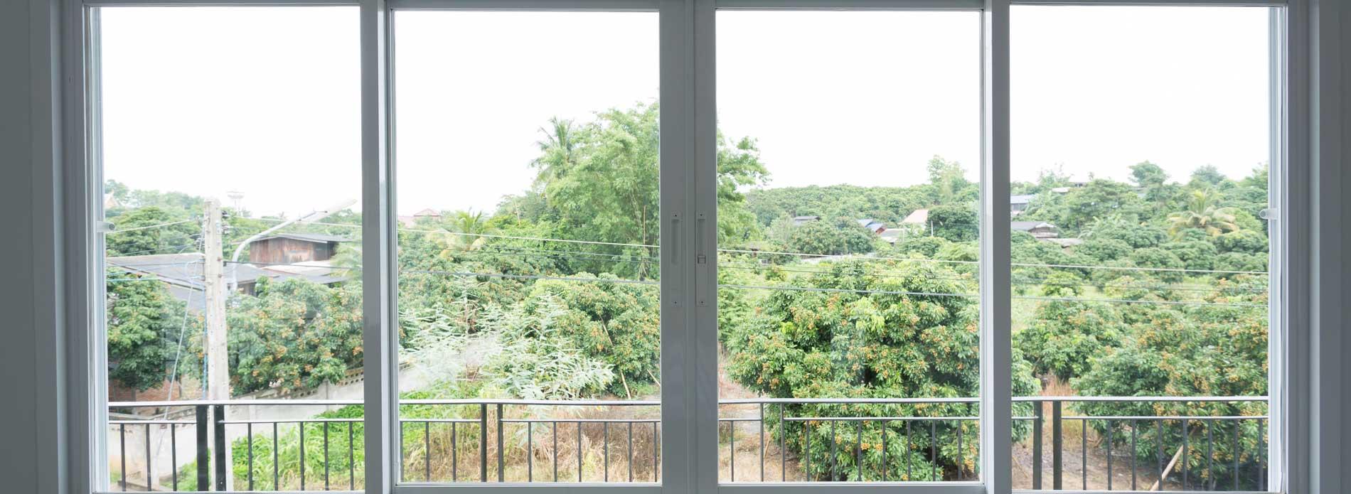 large windows overlooking trees